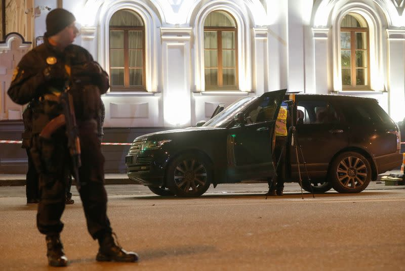 An investigator inspects a car at a site of a murder attempt on Viacheslav Soboliev in Kiev