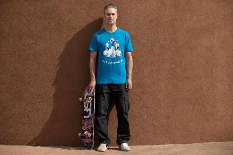 CEO at USA Skateboaring Friedberg with his skateboard in California