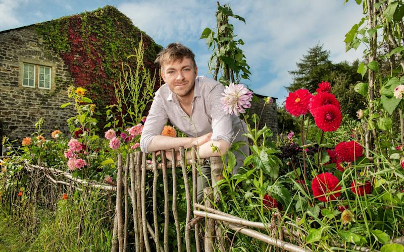 Robin Lucas in his garden in Lancashire, pictured, which he built from scratch during lockdown - Paul Cooper