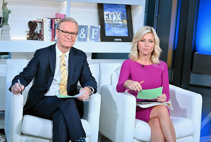 """NEW YORK, NY - SEPTEMBER 24: (EXCLUSIVE COVERAGE) Steve Doocy and Ainsley Earhardt host """"FOX & Friends"""" at Fox News Channel Studios on September 24, 2019 in New York City. (Photo by Slaven Vlasic/Getty Images)"""