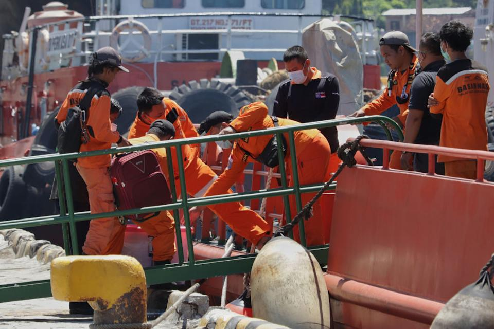 Crew members seen preparing for the search operation to find the submarine.