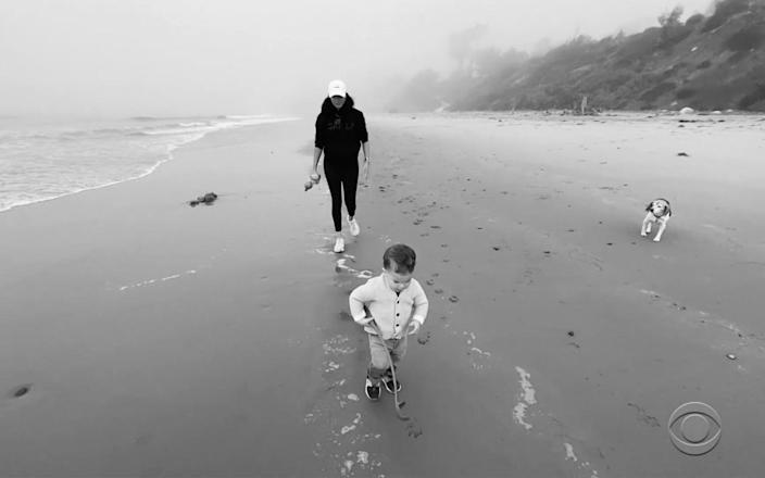 Meghan and Archie pictured on the beach in California - CBS