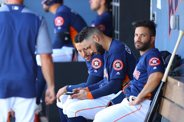<p>Houston Astro Marwin Gonzalez (9) checks mobile device while sitting on the bench with George Springer and Jose Altuve in the fourth inning of a baseball game against the Minnesota Twins at the Ballpark of the Palm Beaches in West Palm Beach, Fla., on Feb. 28, 2018. (Photo: Gordon Donovan/Yahoo News) </p>