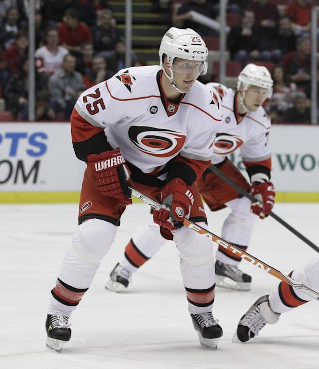 Carolina Hurricanes defenseman Joni Pitkanen (25) of Finland waits for the face off during the first period of an NHL hockey game against the Detroit Red Wings in Detroit, Saturday, March 24, 2012. (AP Photo/Carlos Osorio)