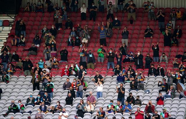 Harlequins fans celebrate a try, but their team were beaten