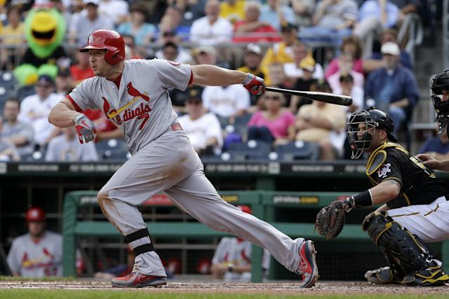 St. Louis Cardinals' Matt Holliday (7) drives in a run with a ground out off Pittsburgh Pirates starting pitcher A.J. Burnett during the third inning of a baseball game in Pittsburgh on Tuesday, July 30, 2013. (AP Photo/Gene J. Puskar)