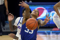 Seton Hall guard Shavar Reynolds Jr., passes the ball past DePaul guard Charlie Moore during the first half of an NCAA college basketball game in Chicago, Saturday, Jan. 9, 2021. (AP Photo/Nam Y. Huh)
