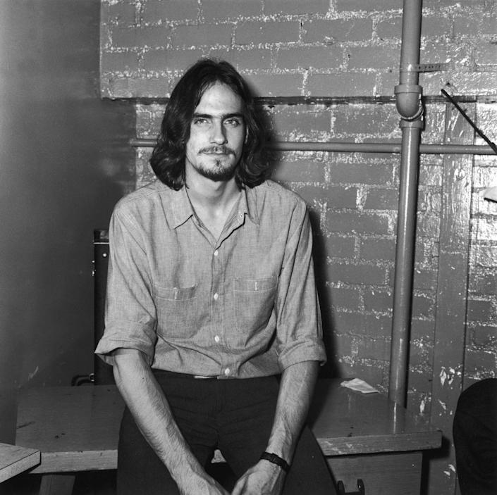 <p>Singer-songwriter James Taylor enjoys a few moments to himself before performing at The Troubadour nightclub in Los Angeles in 1970. </p>