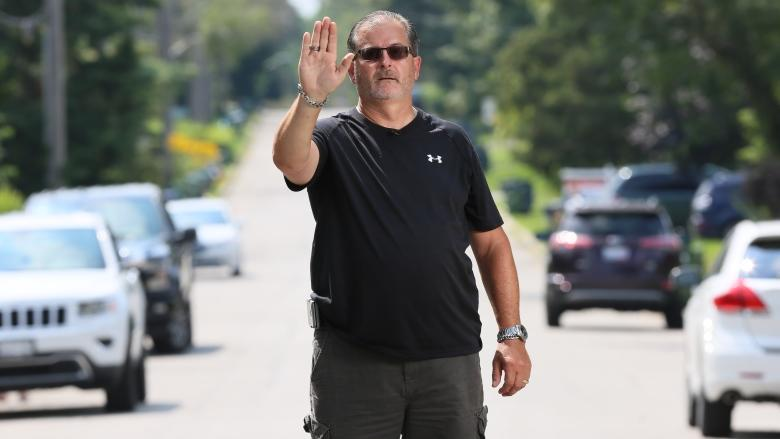 Toronto man stands in the middle of his street to slow speeding drivers