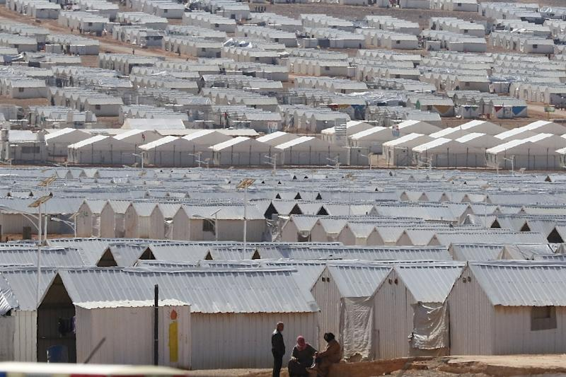 Prefabricated metal homes stretch into the distance at the Azraq camp for Syrian refugees in northern Jordan (AFP Photo/KHALIL MAZRAAWI)