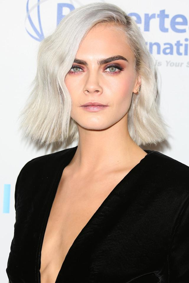 <p>With hair Cara Delevingne's length, you only need one hot tool: a flat iron. Twist and bend the iron as you work down your strands to create these graphic bends.</p>