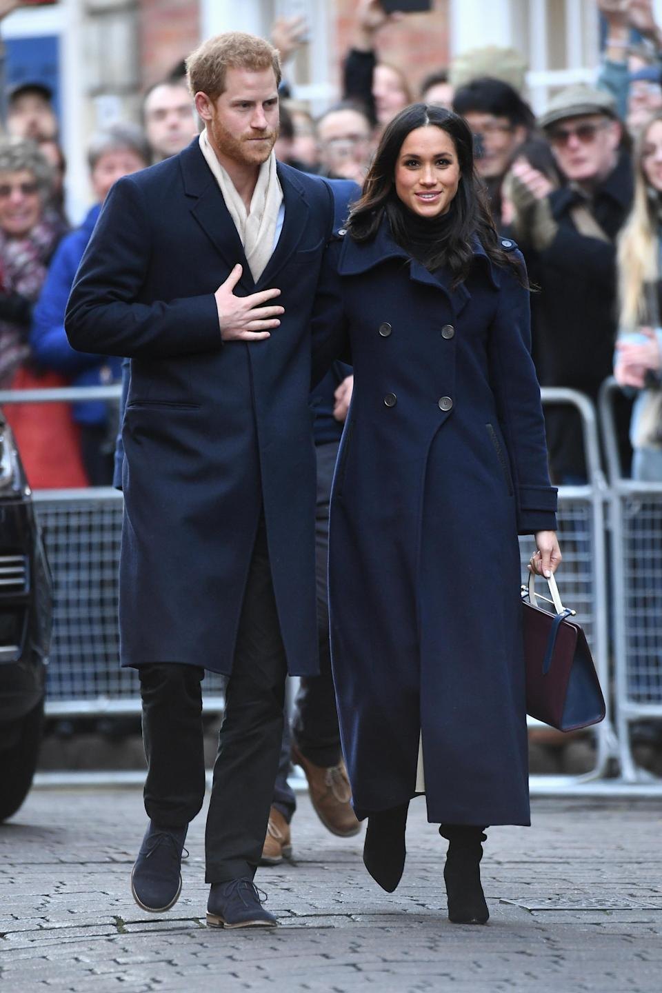 <p>Meghan kicked off royal life with a trip to Nottingham. Harry and the former actress spent the morning visiting two charities with Meghan being showered with bouquets and cards from the public. <i>[Photo: Getty]</i> </p>