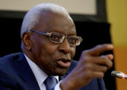 IAAF President Lamine Diack gestures during a joint news conference with IOC President Jacques Rogge at the World Athletics championships in Moscow, Russia, on Friday, Aug. 9, 2013. (AP Photo/Ivan Sekretarev)