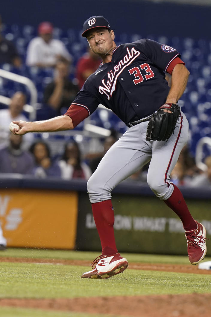 Washington Nationals relief pitcher Ryne Harper (33) catches a ball hit by Miami Marlins' Lewin Diaz (68) during the eighth inning of a baseball game, Wednesday, Sept. 22, 2021, in Miami. (AP Photo/Marta Lavandier)