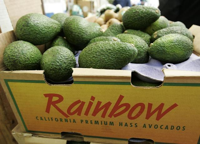 FILE - In this Jan. 17, 2007 photo, California grown avocados are seen on display at a market in Mountain View, Calif. So why the avocado and why the Super Bowl? It helped that the avocado season happens to hit its prime right around kickoff. (AP Photo/Paul Sakuma, File)