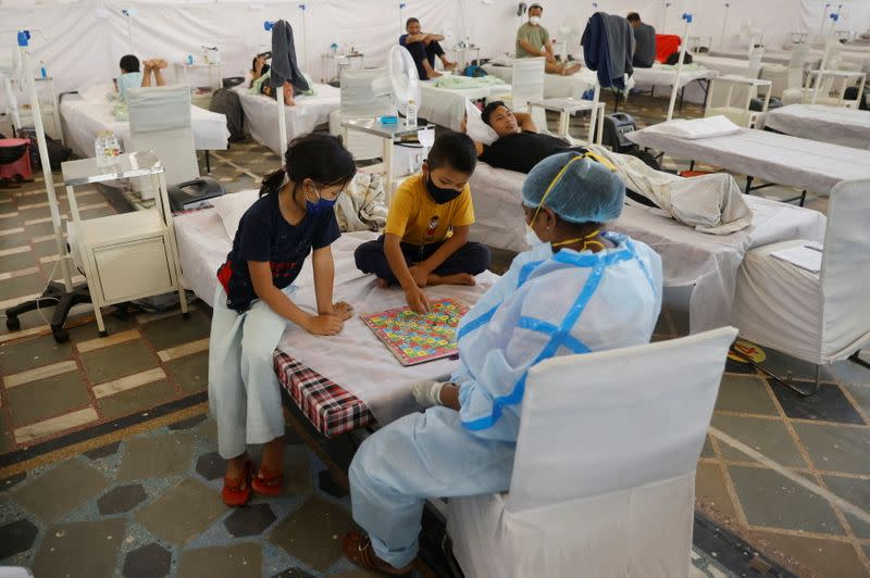 Indian Jew children, members of the Bnei Menashe, suffering from the coronavirus disease play a board game at a COVID-19 care facility inside a Gurudwara or a Sikh Temple, in New Delhi