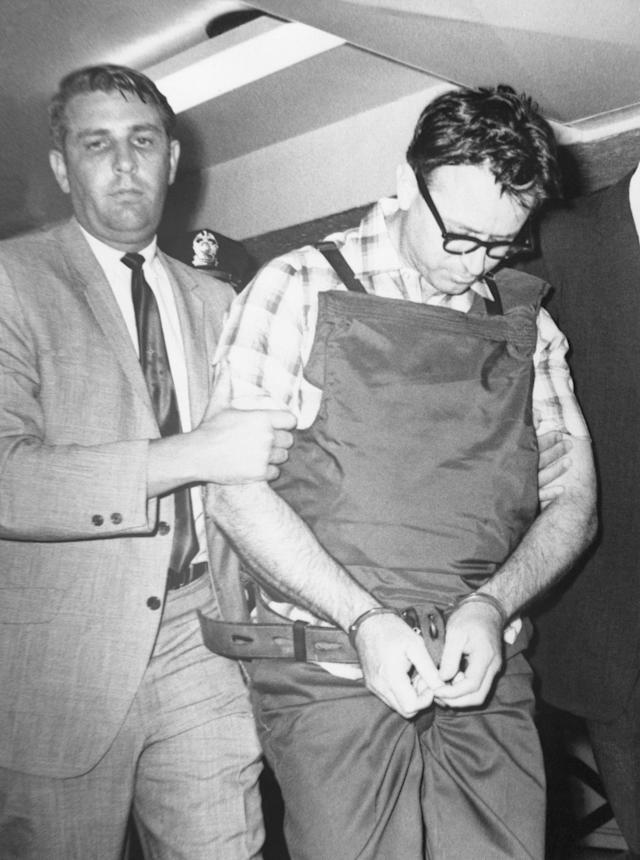 <p>James Earl Ray is led to his cell by Shelby County Sheriff William Morris. (Photo: Bettmann/Getty Images) </p>