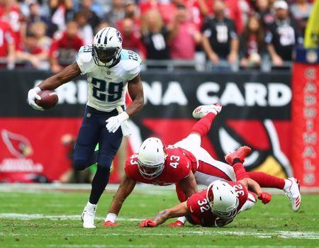 Dec 10, 2017; Glendale, AZ, USA; Tennessee Titans running back DeMarco Murray (29) runs the ball against Arizona Cardinals safety Tyrann Mathieu (32) and linebacker Haason Reddick (43) in the first half at University of Phoenix Stadium. Mandatory Credit: Mark J. Rebilas-USA TODAY Sports