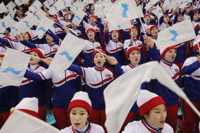 Ice Hockey – Pyeongchang 2018 Winter Olympics – Men Preliminary Round Match – Czech Republic v South Korea - Gangneung Hockey Centre, Gangneung, South Korea – February 15, 2018 - North Korean cheerleaders attend the Czech Republic Vs. South Korea game. REUTERS/Kim Kyung-Hoon