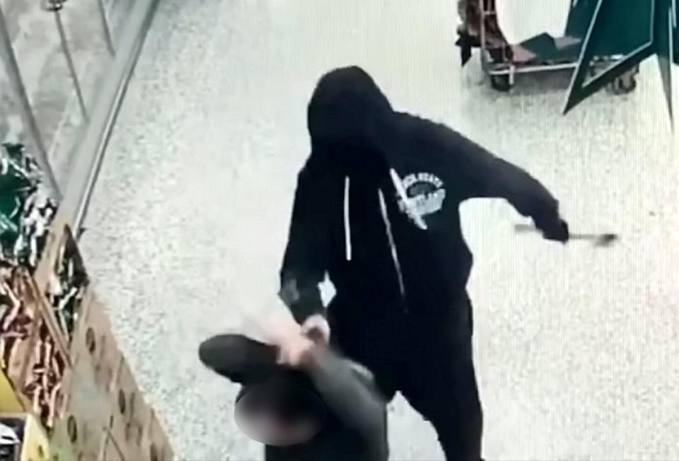 Two men who threatened shop workers with an axe during an armed robbery have been jailed (swns)
