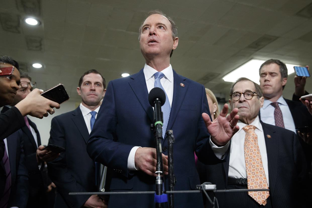 House Democratic impeachment managers including House Intelligence Committee Chairman Adam Schiff, D-Calif., center, with Rep. Jason Crow, D-Colo., left, and Judiciary Committee Chairman Jerrold Nadler, D-N.Y., speaks to the media before attending the fourth day of the impeachment trial of President Donald Trump on charges of abuse of power and obstruction of Congress, Friday, Jan. 24, 2020, on Capitol Hill in Washington. (Photo: Jacquelyn Martin/AP)