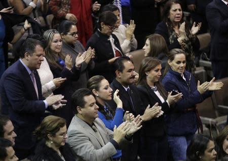 Mexican congressmen applaud after the Mexico Congress approves the biggest oil sector shake-up in the lower house in Mexico City December 12, 2013. REUTERS/Henry Romero