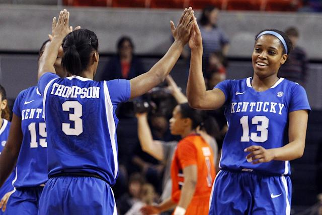 Kentucky's Janee Thompson (3) gives high-fives to teammates, Linnae Harper (15) and Bria Goss (13) after they held on to defeat Auburn 73-71 in an NCAA women's college basketball game on Sunday, Jan. 19, 2014, in Auburn, Ala. (AP Photo/Butch Dill)