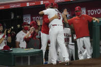 Los Angeles Angels' Albert Pujols, center, returns to the dugout after a solo home run during the fifth inning of the team's baseball game against the Texas Rangers on Friday, Sept. 18, 2020, in Anaheim, Calif. (AP Photo/Ashley Landis)