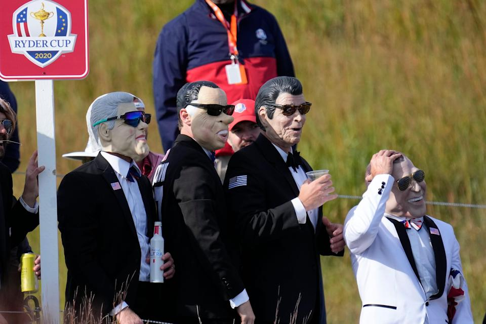 Fans wear forrmer president masks during a foursome match.
