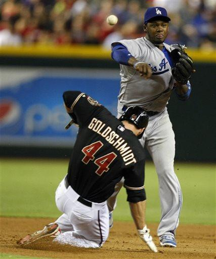 Los Angeles Dodgers shortstop Hanley Ramirez (13), right, turns the double play while avoiding Arizona Diamondbacks' Paul Goldschmidt (44) in the fourth inning during a baseball game on Monday, July 8, 2013, in Phoenix. (AP Photo/Rick Scuteri)