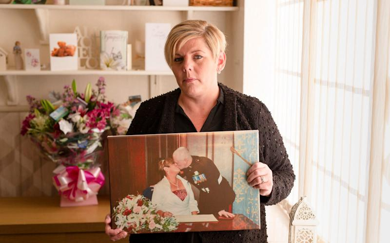 Jo Jukes at her home in Birmingham. Her husband, Dave, killed himself in their garden after repeated pleas for help with his mental health were ignored - Andrew Fox
