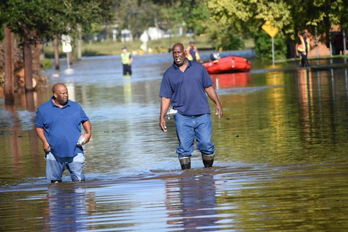 John Joseph, left, and Danny Ellis walk down 13th Street off Willow Glen Road in Alexandria, Louisiana, on Saturday.