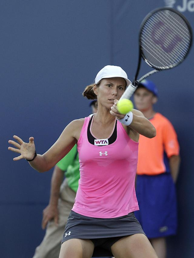 Varvara Lepchenko, of the United States, returns the ball to Angelique Kerber, from Germany, during the first set of a semifinal in the Bank of the West Classic tennis tournament in Stanford, Calif., Saturday, Aug. 2, 2014. (AP Photo/Jeff Chiu)