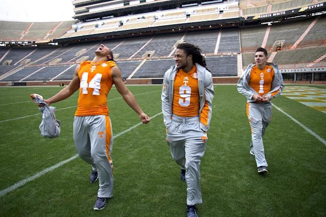 University of Tennessee NCAA college football signees Jakob Johnson, of Jacksonville, Fla., left, Von Pearson, of Newport News, Va., and Jalen Hurd, of Hendersonville, Tenn., walk in Neyland Stadium after being introduced on Wednesday, Feb. 5, 2014, in Knoxville, Tenn. (AP Photo/Knoxville News Sentinel, Saul Young)