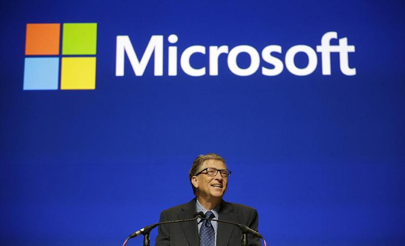 Microsoft chairman Bill Gates speaks at the company's annual shareholders meeting Tuesday, Nov. 19, 2013, in Bellevue, Wash. The company, based in Redmond, Washington, says that all of its proposals, including the re-election of board nominees including Steve Ballmer and Gates, were approved. (AP Photo/Elaine Thompson)