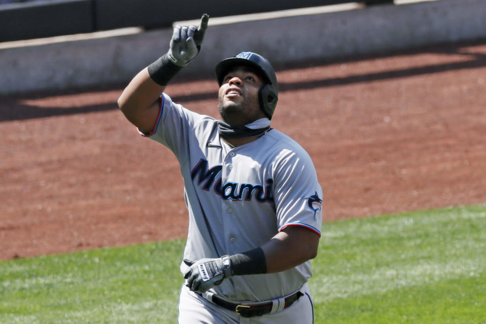 Miami Marlin's first baseman Jesus Aguilar points skyward as he trots the bases after hitting a solo home run during the fifth inning of a baseball game against the New York Mets at Citi Field, Sunday, Aug. 9, 2020, in New York. (AP Photo/Kathy Willens)