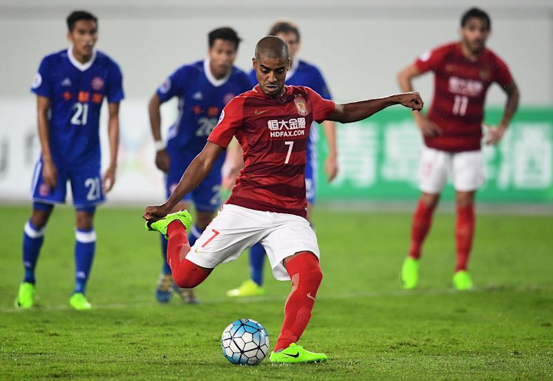 Alan Douglas de Carvalho of Guangzhou Evergrande takes a penalty during the team's AFC Champions League group stage football match against Eastern FC in Guangzhou