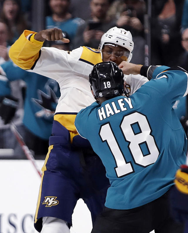 Nashville Predators' Wayne Simmonds, left, and San Jose Sharks' Micheal Haley (18) fight during the first period of an NHL hockey game Saturday, March 16, 2019, in San Jose, Calif. (AP Photo/Ben Margot)