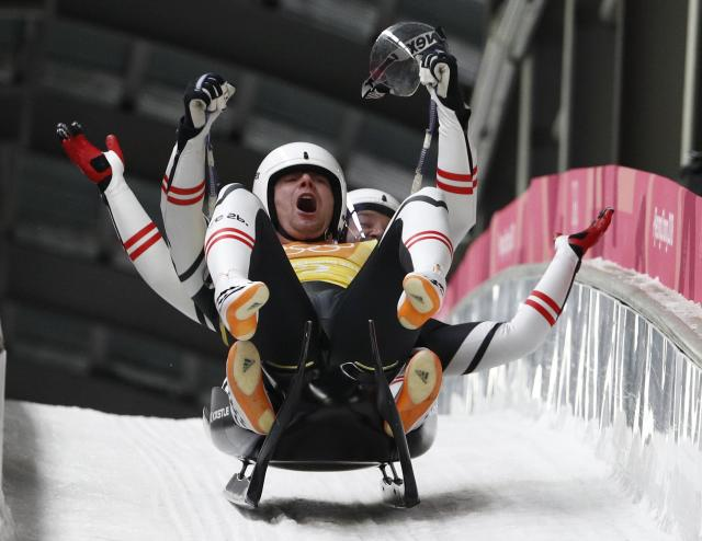 Luge - Pyeongchang 2018 Winter Olympic Games - Team Relay - Pyeongchang, South Korea - February 15, 2018 - Peter Penz and Georg Fischler of Austria celebrate. REUTERS/Edgar Su