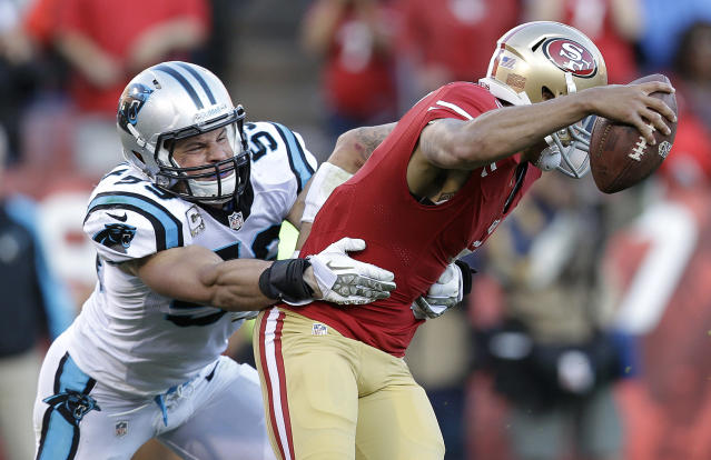 Carolina Panthers middle linebacker Luke Kuechly, left, sacks San Francisco 49ers quarterback Colin Kaepernick during the fourth quarter of an NFL football game in San Francisco, Sunday, Nov. 10, 2013. (AP Photo/Marcio Jose Sanchez)