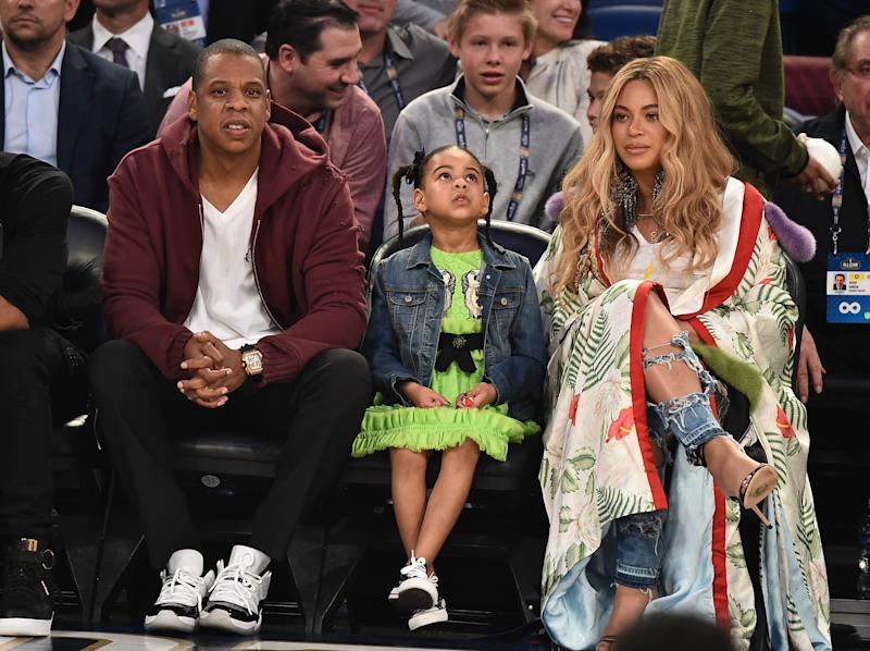 Jay-Z, Blue Ivy Carter and Beyonce Knowles attend a basketball game in 2017 in New Orleans, Louisiana. [Theo Wargo/Getty Images]