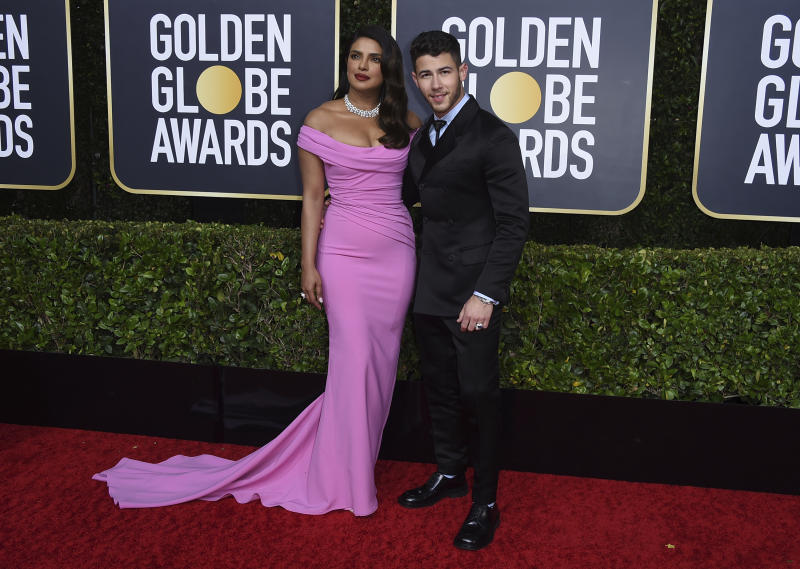 Priyanka Chopra, left, and Nick Jonas arrive at the 77th annual Golden Globe Awards at the Beverly Hilton Hotel on Sunday, Jan. 5, 2020, in Beverly Hills, Calif. (Photo by Jordan Strauss/Invision/AP)