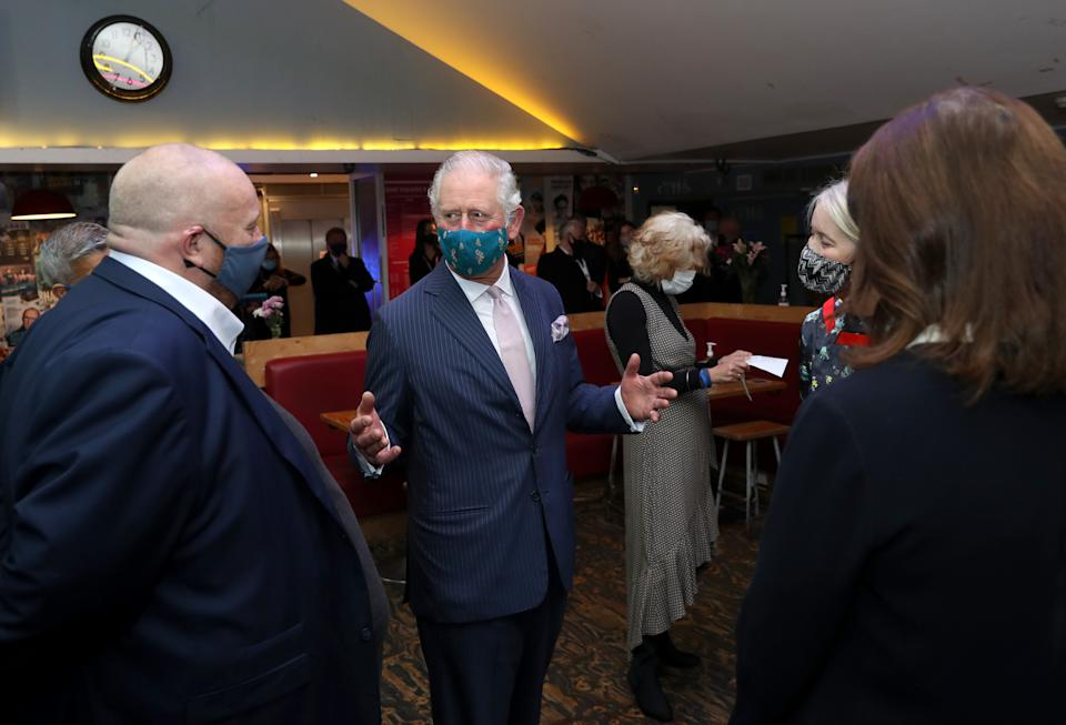 LONDON, ENGLAND - DECEMBER 03: Prince Charles, Prince of Wales wears a face mask as he speaks to senior representatives during his visit to Soho Theatre with Camilla, Duchess of Cornwall to celebrate London's night economy on December 03, 2020 in London, England. (Photo by Chris Jackson - WPA Pool/Getty Images)