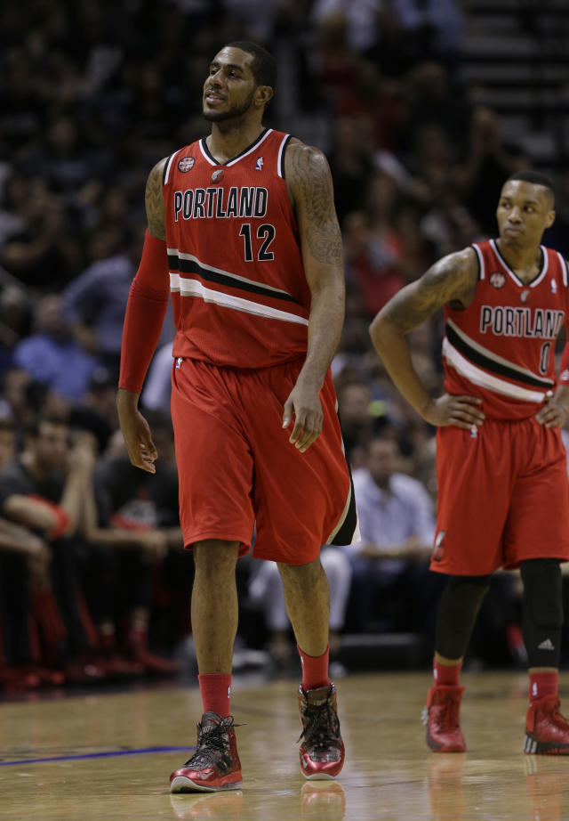 "<a class=""link rapid-noclick-resp"" href=""/nba/teams/por/"" data-ylk=""slk:Portland Trail Blazers"">Portland Trail Blazers</a>' <a class=""link rapid-noclick-resp"" href=""/nba/players/4130/"" data-ylk=""slk:LaMarcus Aldridge"">LaMarcus Aldridge</a> (12) and <a class=""link rapid-noclick-resp"" href=""/nba/players/5012/"" data-ylk=""slk:Damian Lillard"">Damian Lillard</a> (0) during the second half of Game 5 of a Western Conference semifinal NBA basketball playoff series against the <a class=""link rapid-noclick-resp"" href=""/nba/teams/sas/"" data-ylk=""slk:San Antonio Spurs"">San Antonio Spurs</a>, Wednesday, May 14, 2014, in San Antonio. (AP Photo/Eric Gay)"
