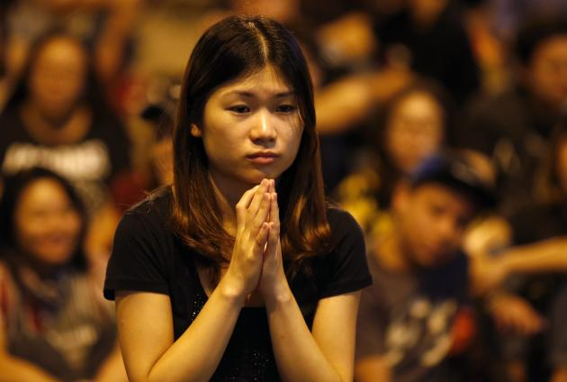 A woman reacts as pro-democracy protestors gather outside the government headquarters office in Hong Kong.