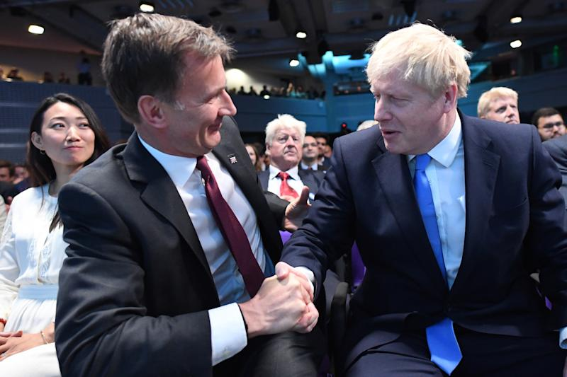 Jeremy Hunt (left) congratulates Boris Johnson at the Queen Elizabeth II Centre in London where he was announced as the new Conservative party leader, and will become the next Prime Minister (Picture: PA)