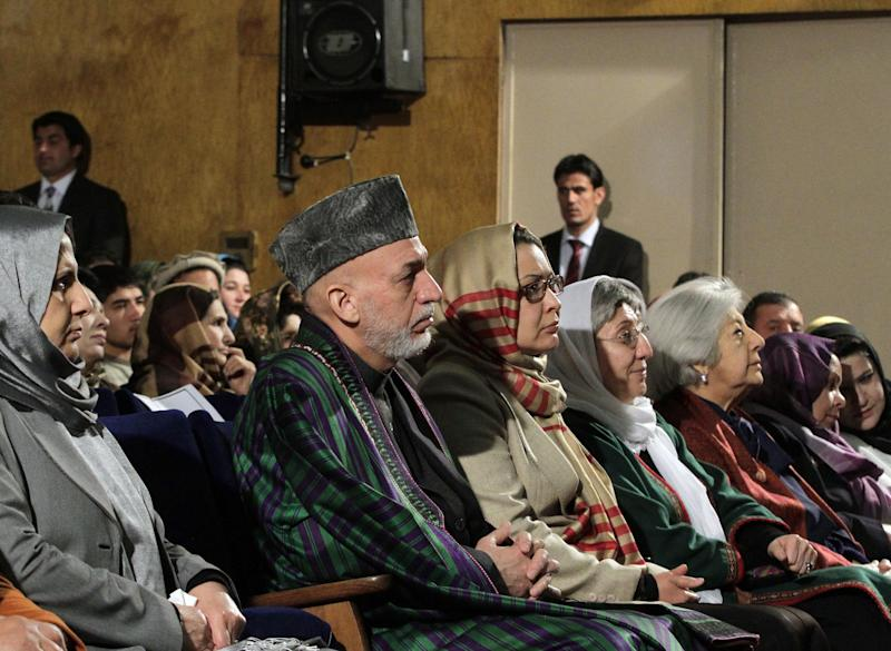 Afghan President Hamid Karzai sits among the audience prior to his nationally televised speech about the state of Afghan women in Kabul, Afghanistan, Sunday, March, 10, 2013. Karzai on Sunday accused the Taliban and the U.S. of working in concert to convince Afghans that violence will worsen if most foreign troops leave as planned by the end of next year. Karzai says two deadly suicide bombings on Saturday show the insurgent group is conducting attacks to help show that international forces will still be needed to keep the peace after their current combat mission ends in 2014. (AP Photo/Ahmad Jamshid)