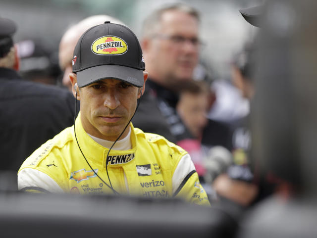 Helio Castroneves, of Brazil, waits during qualifications for the IndyCar Indianapolis 500 auto race at Indianapolis Motor Speedway in Indianapolis, Saturday, May 19, 2018. (AP Photo/Darron Cummings)