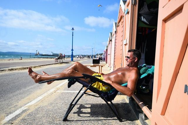 Stuart Henderson enjoys the Autumn sunshine from his beach hut in Bournemouth