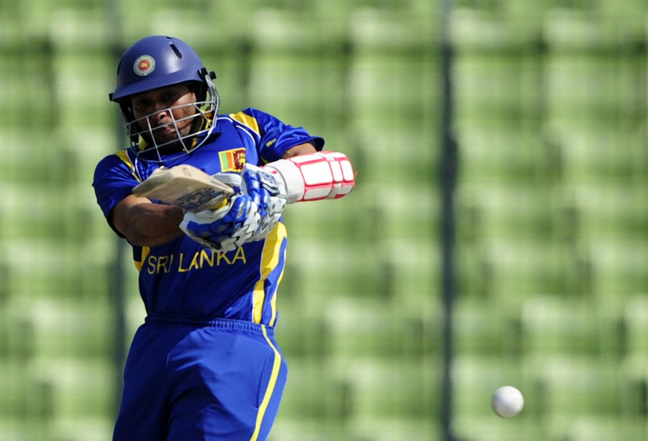 Sri Lankan batsman Tillakaratne Dilshan plays a shot during the one day international (ODI) Asia Cup cricket match between Pakistan and Sri Lanka at The Sher-e-Bangla National   Cricket Stadium in Dhaka on March 15, 2012.